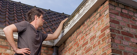 dakgoten schilderen en onderhouden